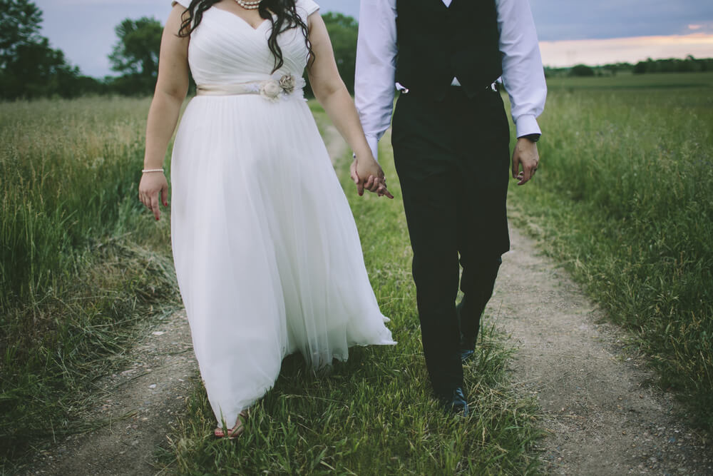 Plus size bride wearing white dress