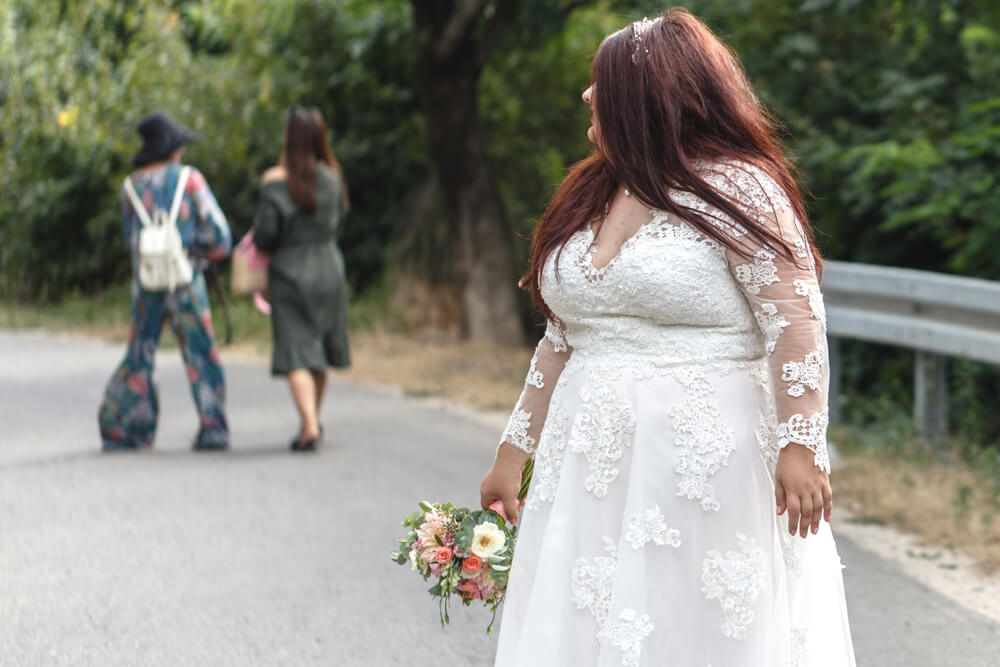 Plus size bride in wedding dress