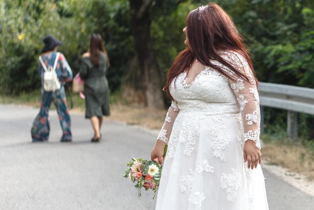 Plus size bride in wedding dress