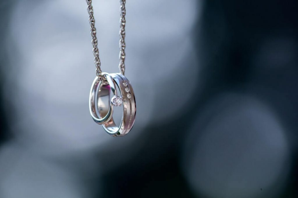 Wedding and engagement ring on white gold necklace