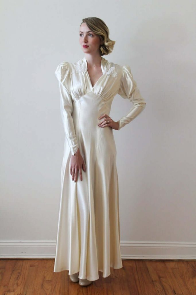 Bride wearing ruched sleeve dress