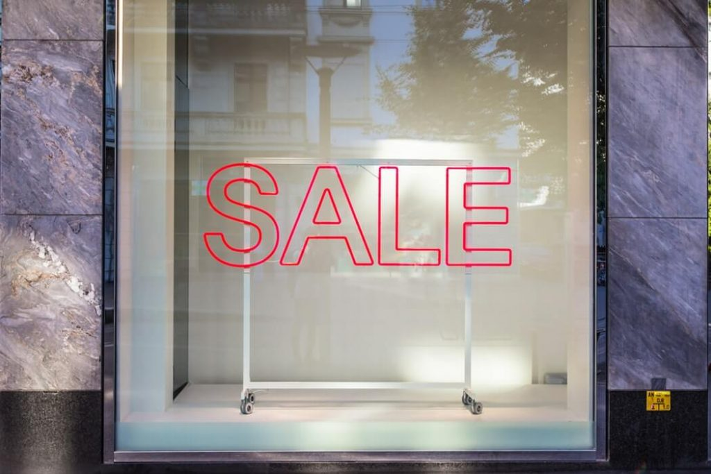 Shop's window showing sale