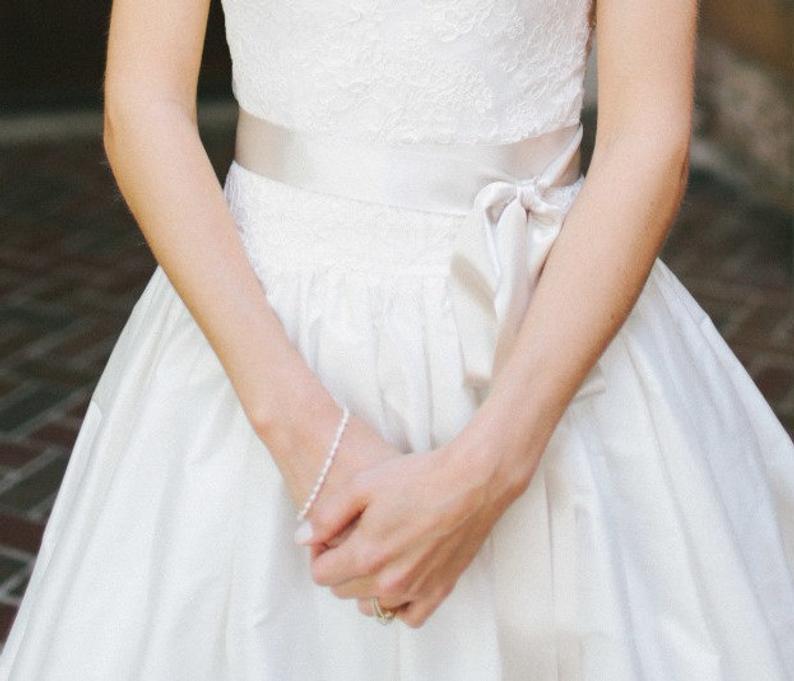 Bride with satin sash