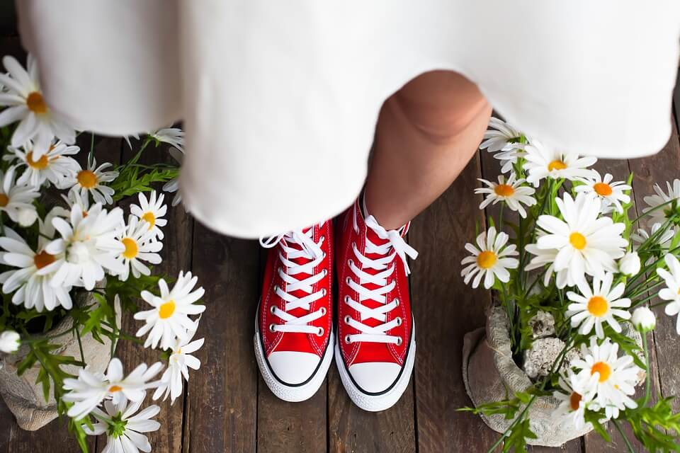 Bride wearing sneakers at her summer wedding day
