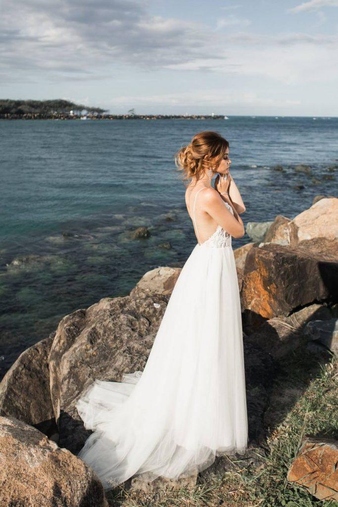 Bride wearing white sweep train wedding dress