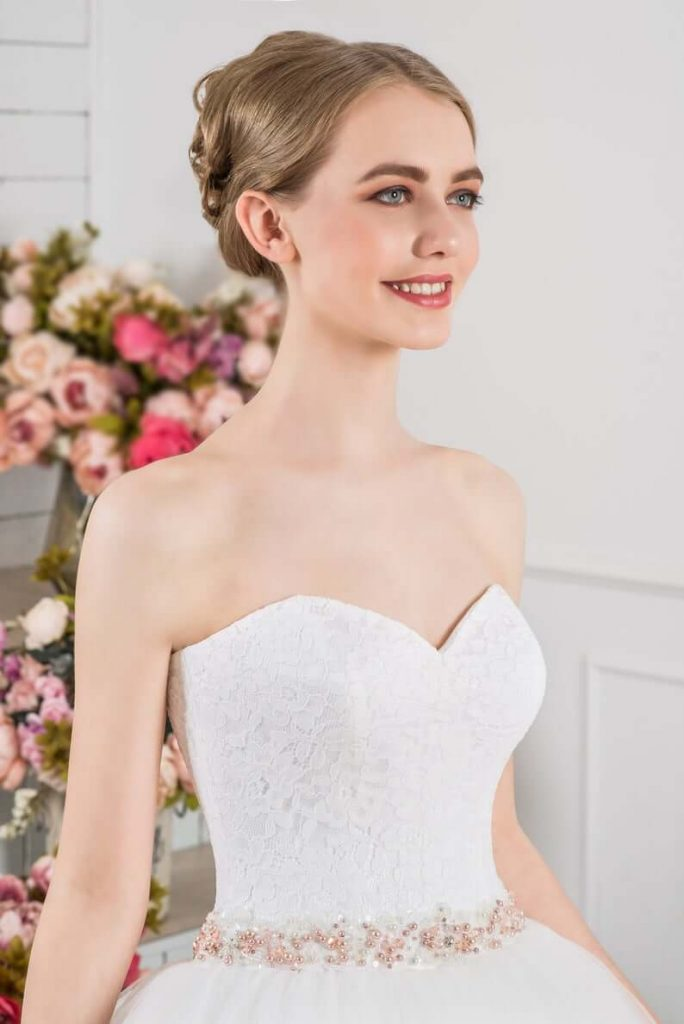 Bride wearing sweetheart neckline wedding dress