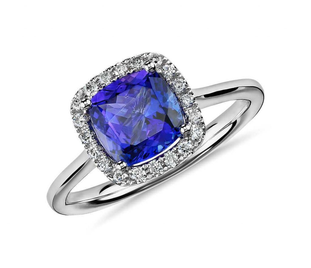 Deeo blue tanzanite engagement ring close up halo setting