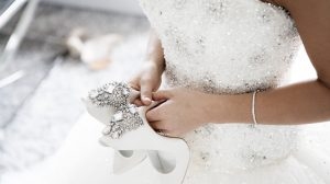 Bride wearing tennis bracelet on her wedding day