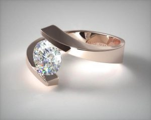 Tension set minimalist style engagement ring in rose gold