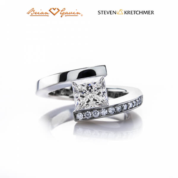 Tension set engagement ring face up