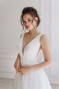 Girl wearing v-neck wedding dress