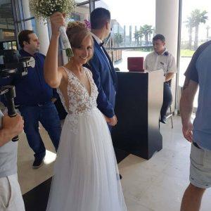 Bride wearing v-neck wedding dress