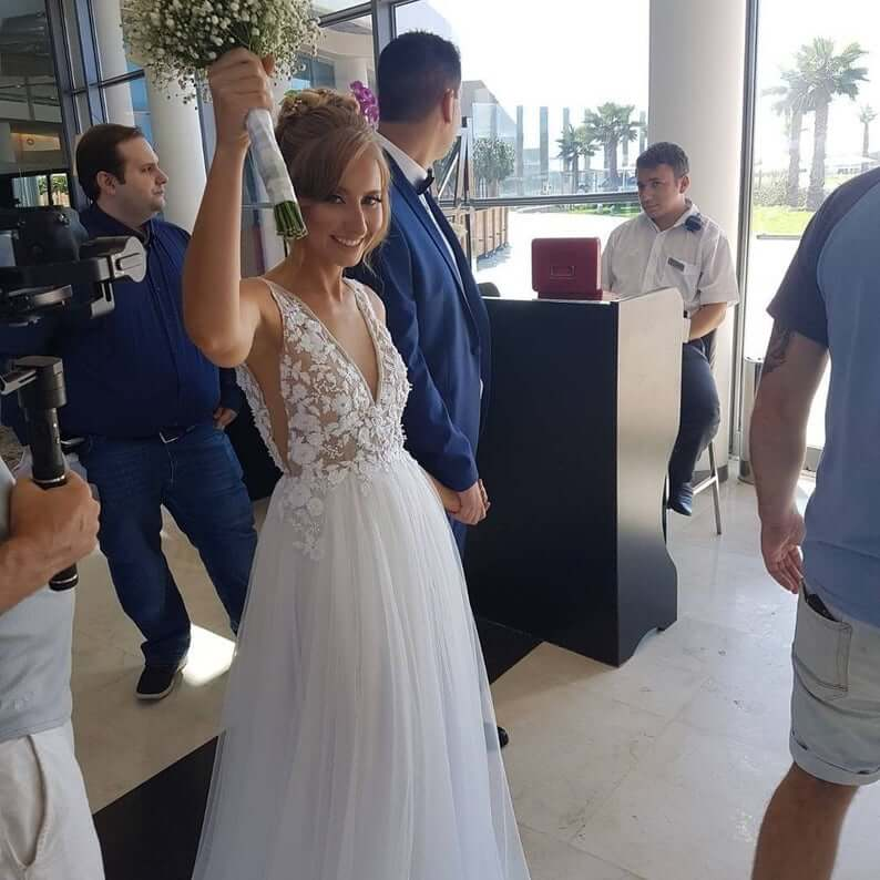 Bride wearing v-neck wedding dress
