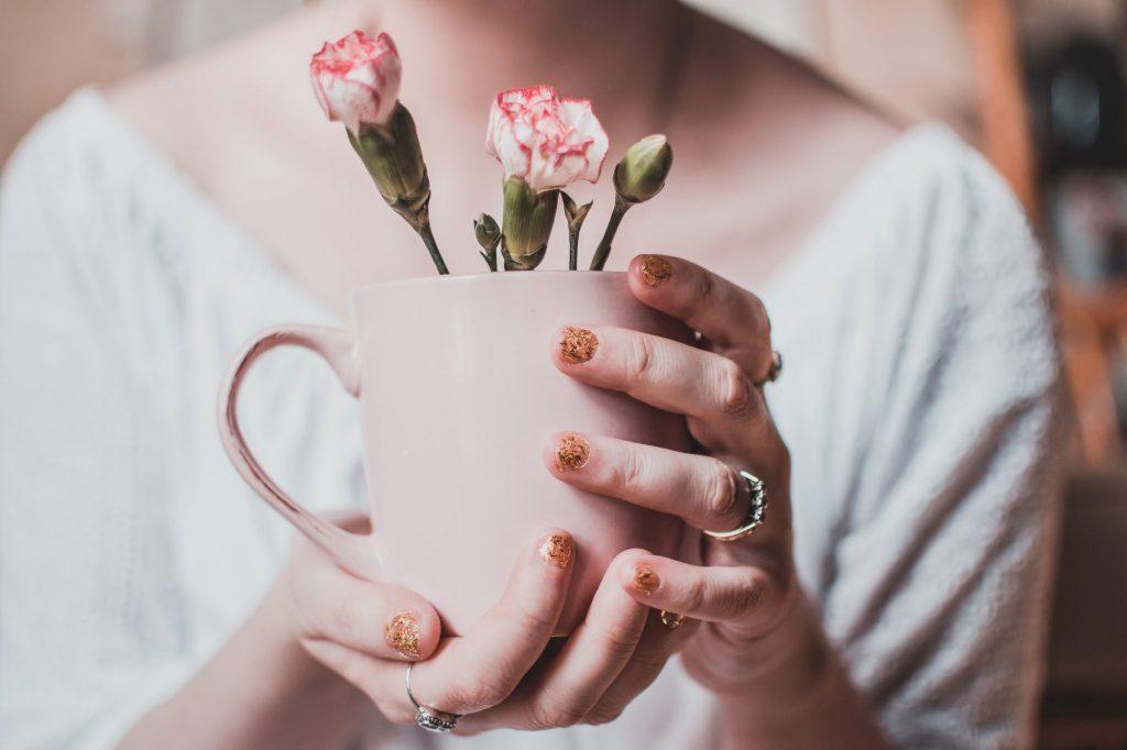 Girl holding a mug