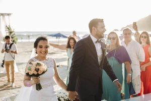 Couple in beach wedding venue holding hands