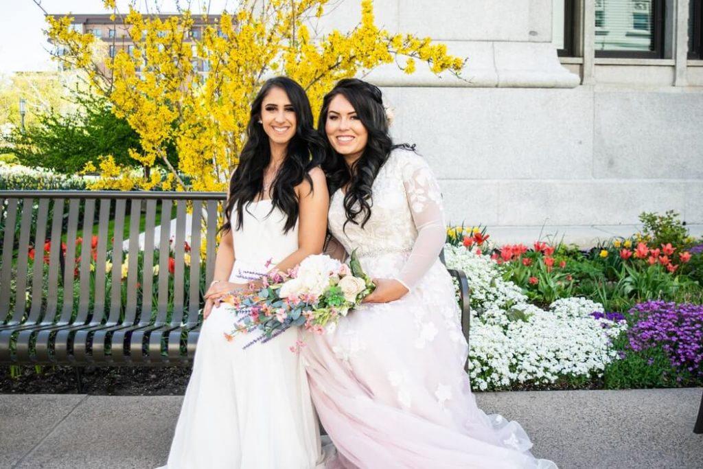 Bride sitting next to her best friend