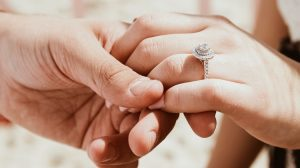 Bride holding grooms hand