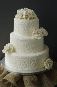 All white lace wedding cake