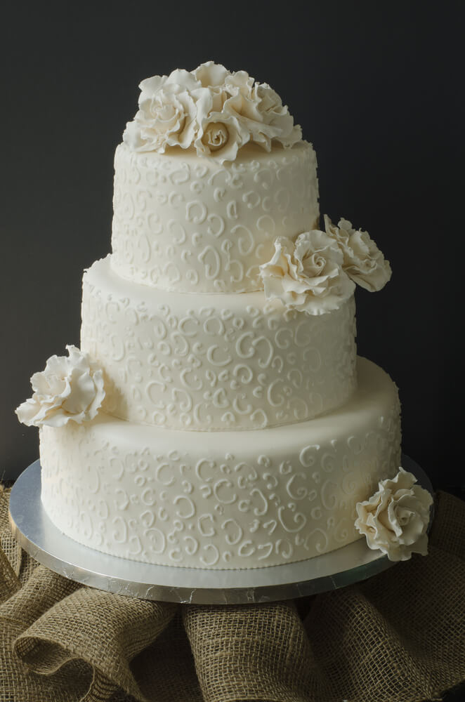 All white lace wedding cake