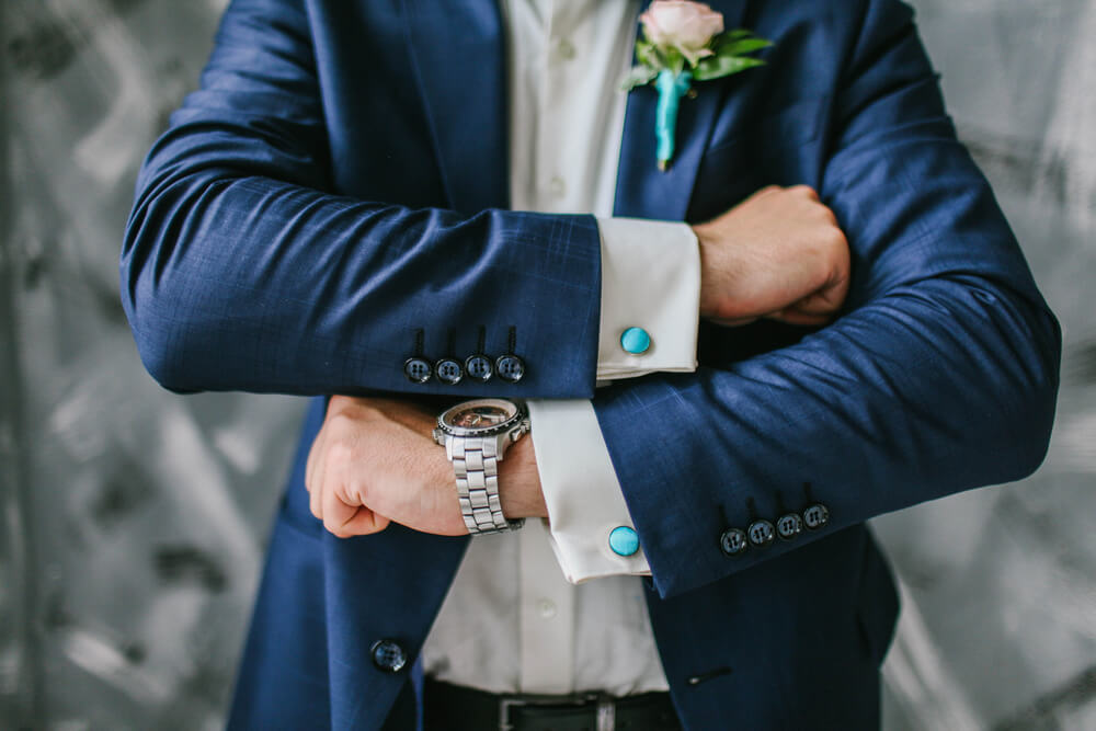 Groom showing off his cufflinks