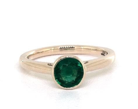 Bezel set green emerald engagement ring