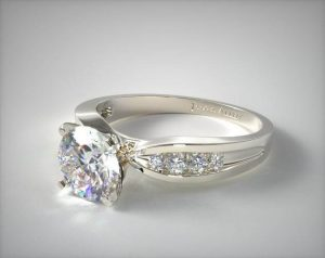 Bow-tie-channel setting engagement ring