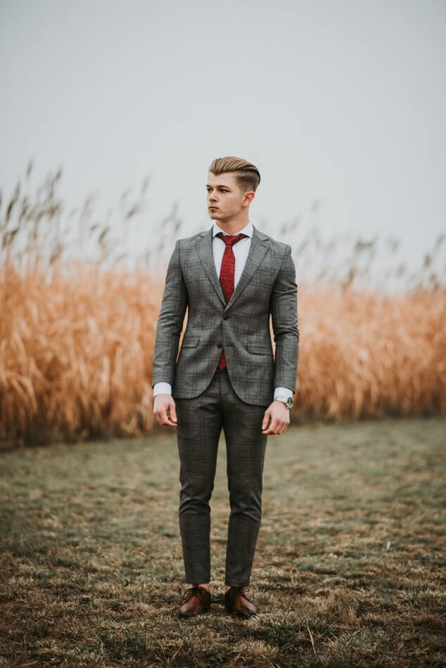 Groom wearing casual suit