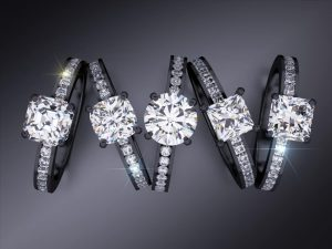 Channel-set engagement rings in black gold