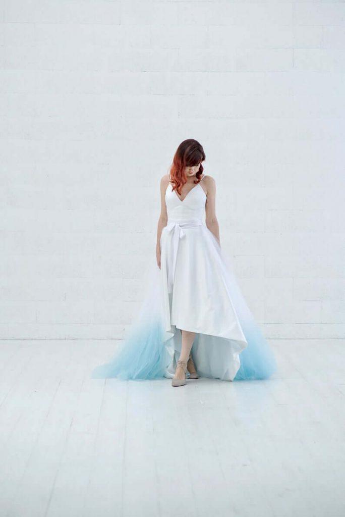 Bride wearing detachable wedding train