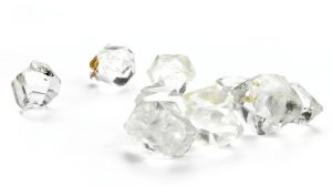 Gemstones that look like diamond on white background closeup