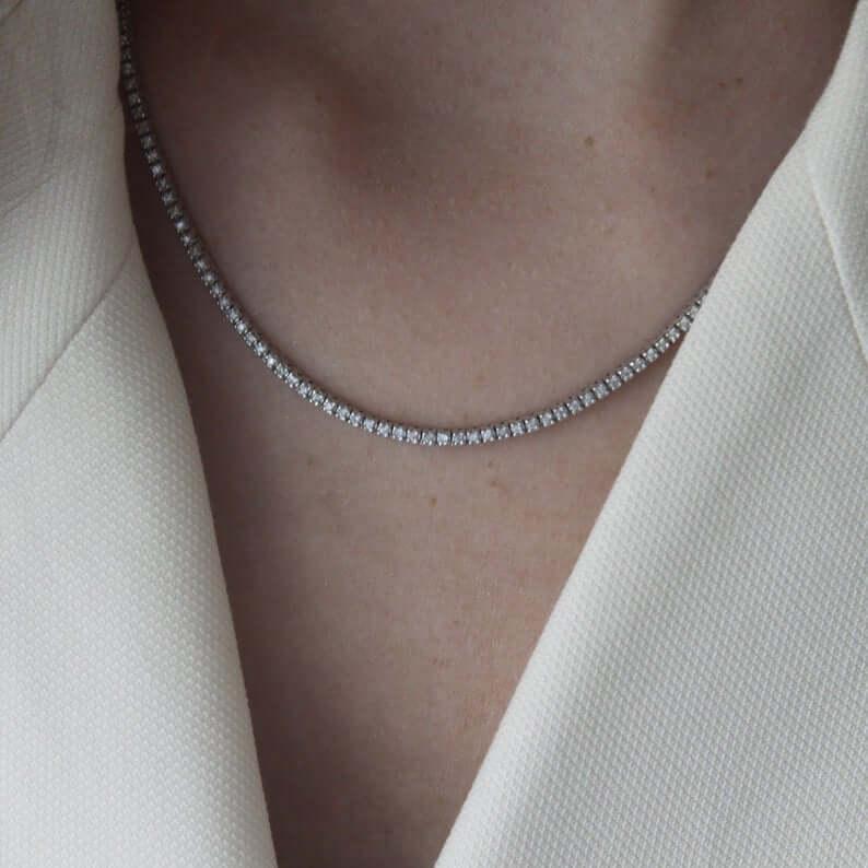 Woman wearing diamond tennis necklace