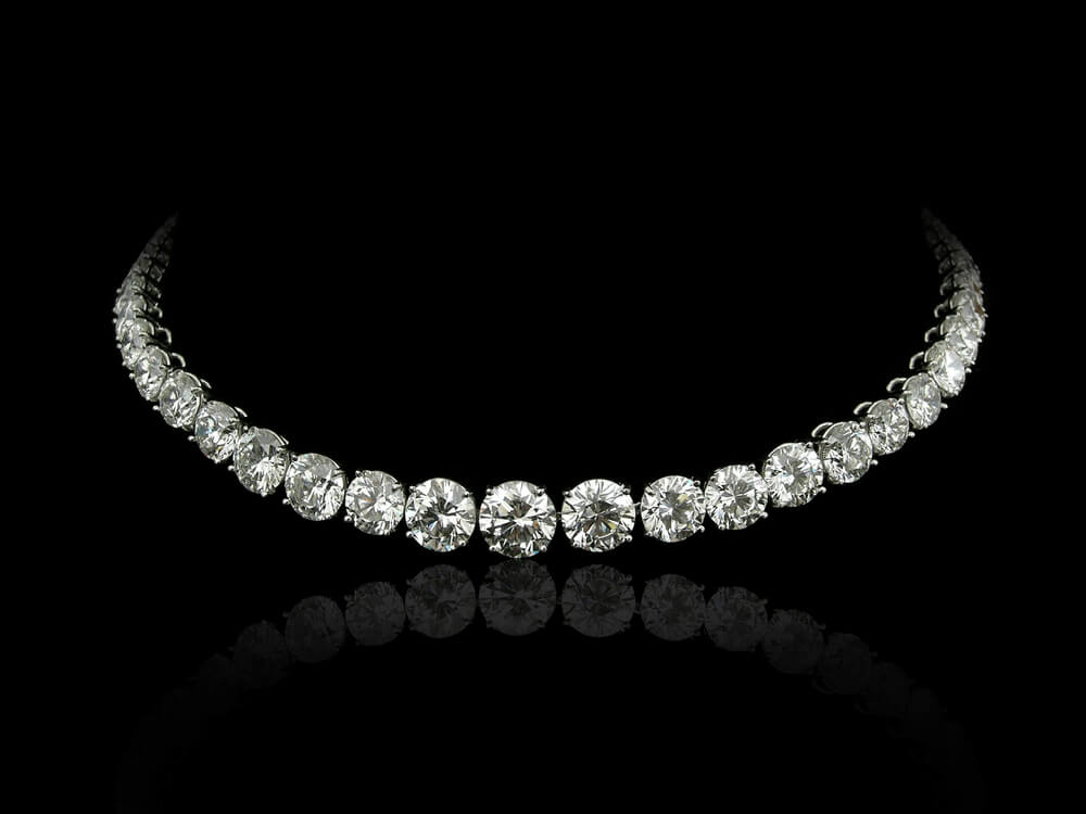 Diamond tennis necklace in black background