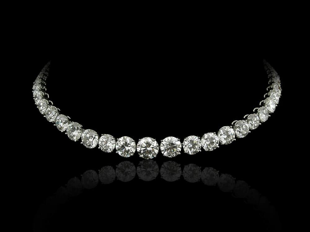 Diamond tennis necklace in black background
