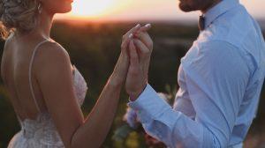 Couple holding hand at the sunrise