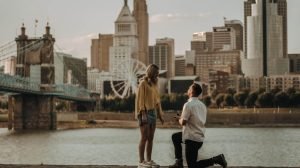Man on his knees proposing in a river background