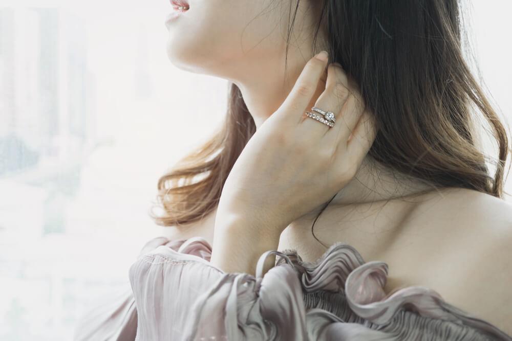 Girl with eternity ring on her finger