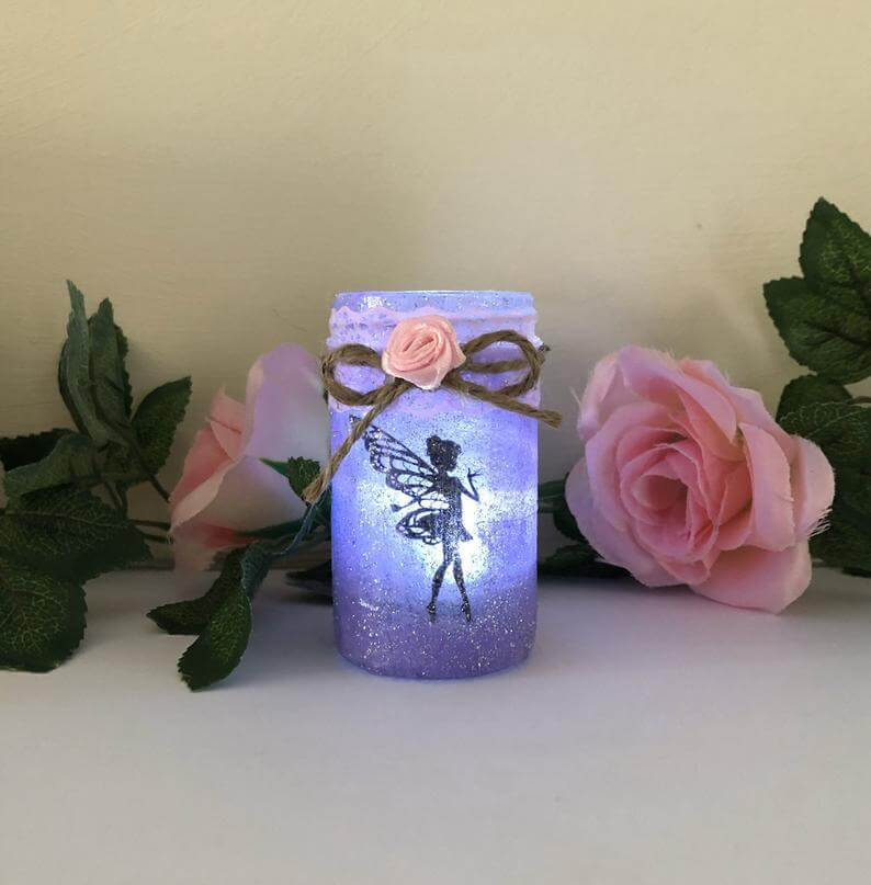 Fairy light mason jar as wedding favor