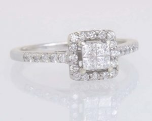 Four stone invisible setting ring