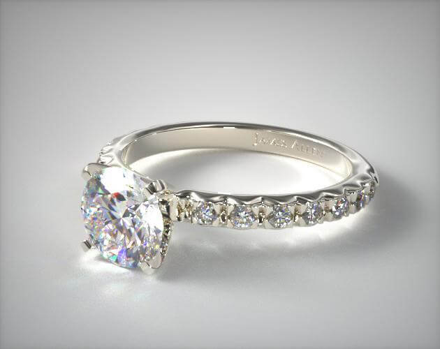 French pave engagement ring with round shape diamond