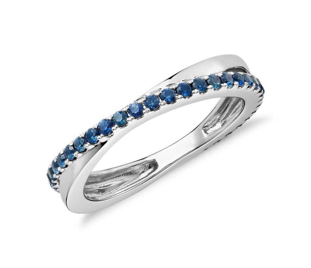 Blue gemstone eternity ring