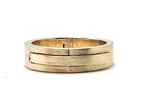 Gold wedding band hinged