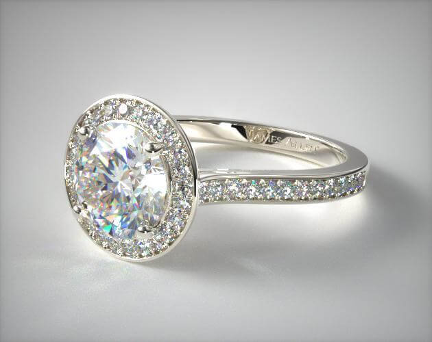 Halo-channel engagement ring with round shape diamond and white gold
