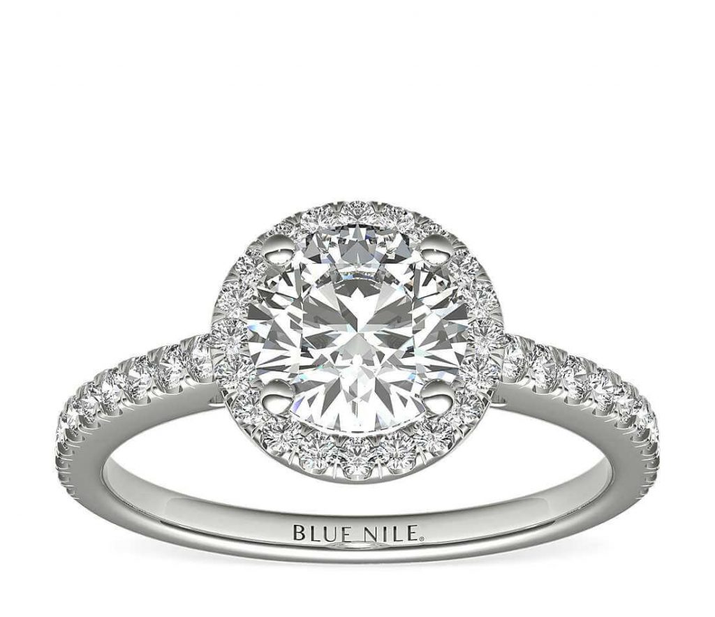 Round shape diamond in halo-channel setting engagement ring