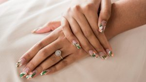 Woman wearing halo ring setting