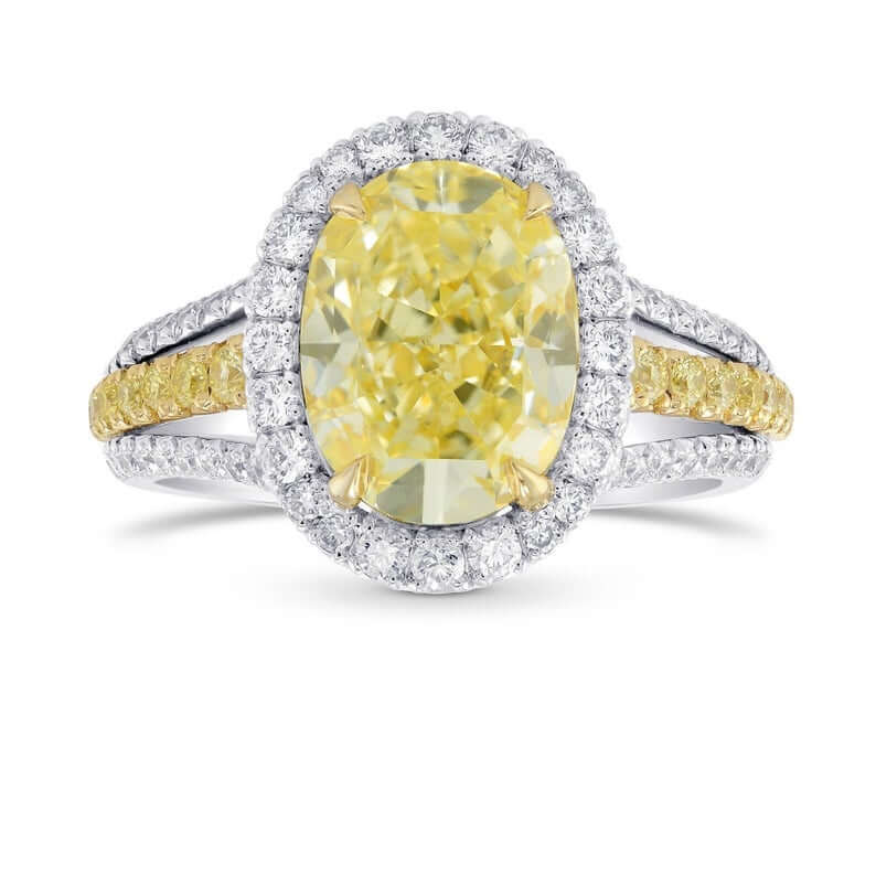 Halo setting engagement ring with yellow diamond