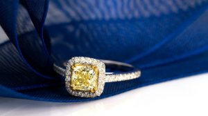 Yellow diamond engagement ring closeup
