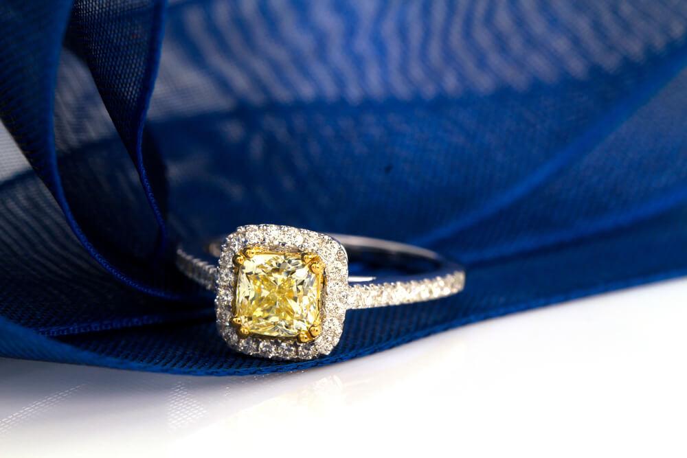 Yellow diamond engagement ring closeup