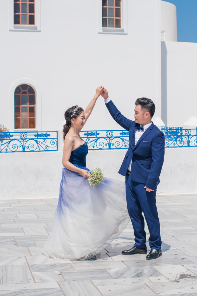 Groom wearing matching suit to bride's dress