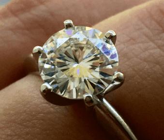 Moissanite ring with oil slick