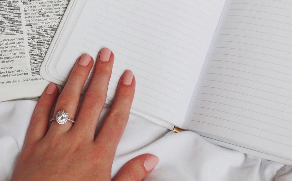 Girl wearing pave set engagement ring
